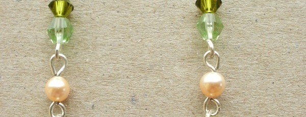 Inima1+-+Cristale+Swarovski+10mm+++Cristale+biconice+Swarovski+4mm+++Perla+Swarovski+4mm+++Elemente+metalice+argintate+-+15+ron